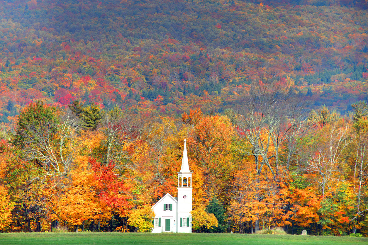 Quintessential fall New England in the small town of Wonalancet, New Hampshire. Photo taken of the vivid colors during the peak fall foliage season. New Hampshire is one of New England's most popular fall foliage destinations bringing out some of the best foliage in the United States