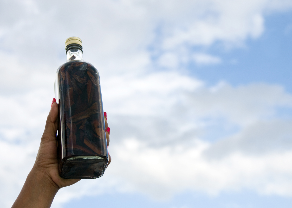 """Bottle of """"Mamajuana"""" , the typical homemade roots beverage of Dominican Republic."""