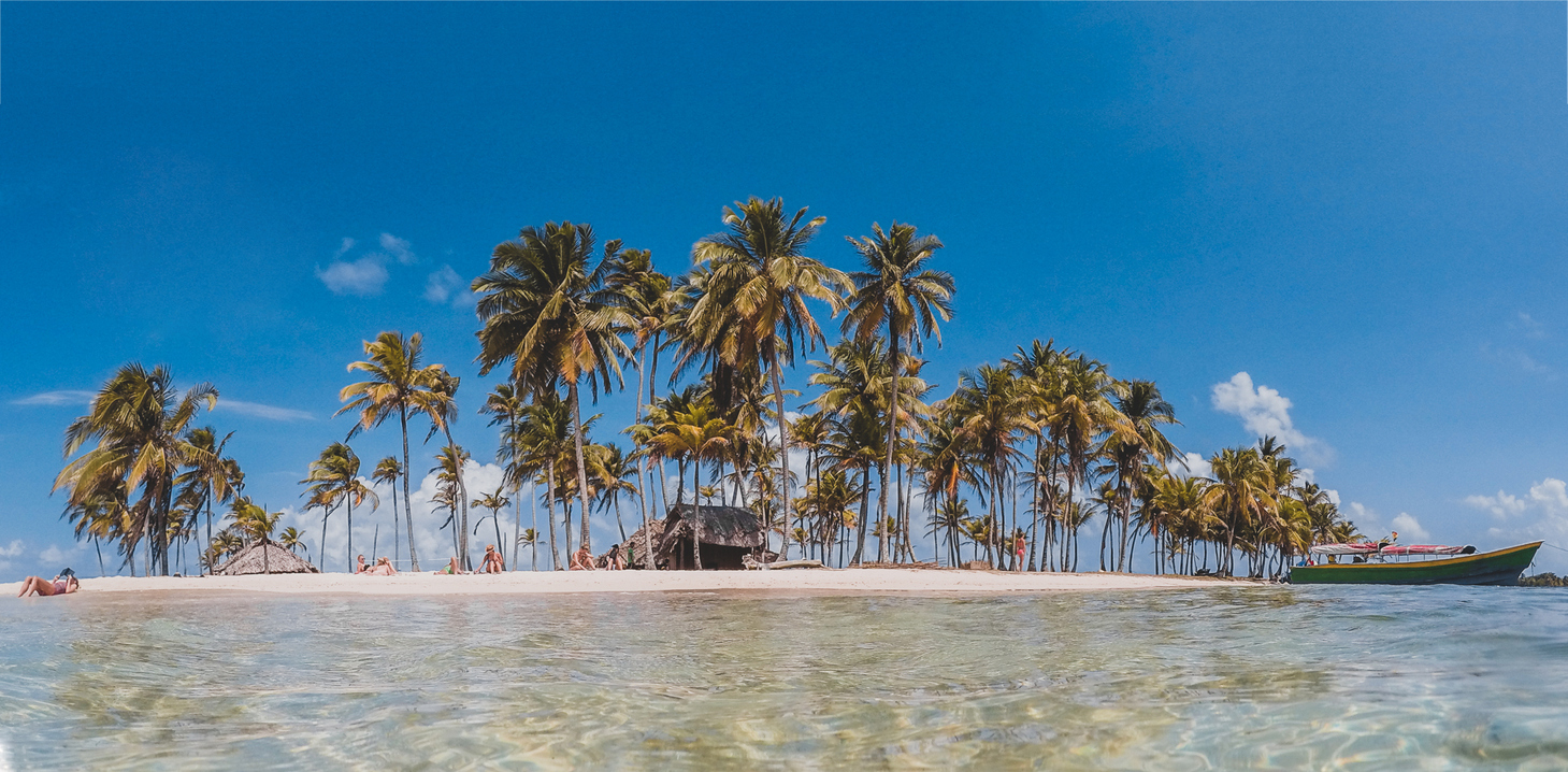 small tropical island with palm trees - summer vacation paradise