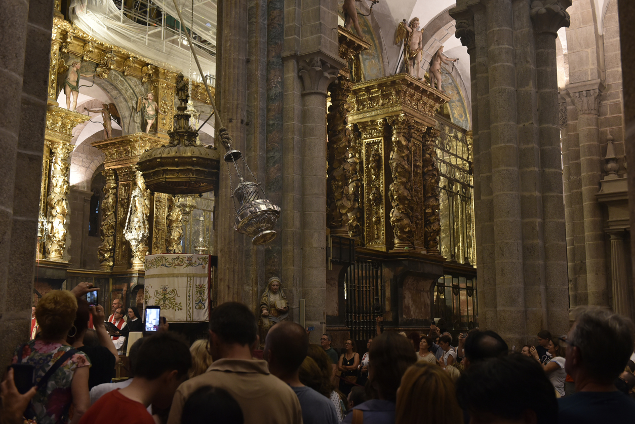 In the cathedral at Santiago de Compostela, congregants watch the famous swinging of the botafumerio (incense burner, or censer). The city and cathedral of Santiago de Compostela is the endpoint for many pilgrims who walk the Camino de Santiago. (July 2018)