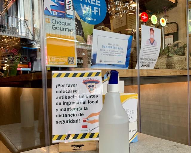 L2F Jul 20 pic Spain reopens Madrid restaurant front door