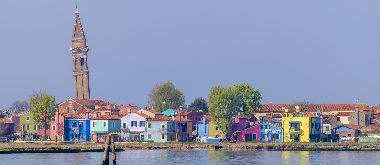 Burano is an archipelago of four islands linked by bridges in the Venetian Lagoon, well known for its lace work and brightly coloured houses. Venice, Italy